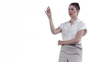 Businesswoman standing while interacting with a virtual touchscreen — Stock Video