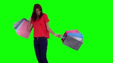 Woman happily swinging shopping bags — Stock Video