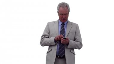 Businessman typing on his phone while looking away — Stock Video