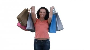 Woman with shopping bags smiling — Stock Video