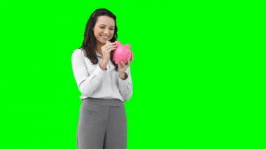 A woman holding a piggy-bank — Stock Video