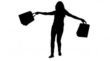 Silhouette of an energetic woman holding shopping bags — Stock Video