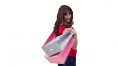 Woman happily holding shopping bags — Stock Video