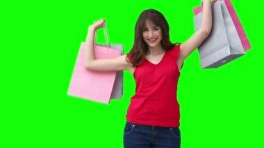 Woman raising shopping bags — Stock Video