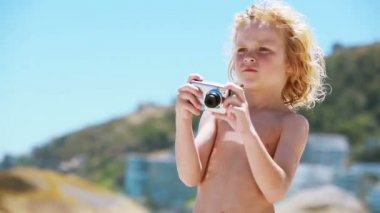 Child using a digital camera — Stock Video