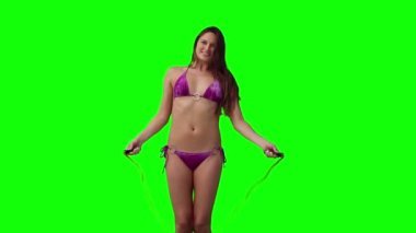 Woman playing with a skipping — Stock Video
