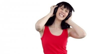 Woman dancing happily as she listens to music — Stock Video