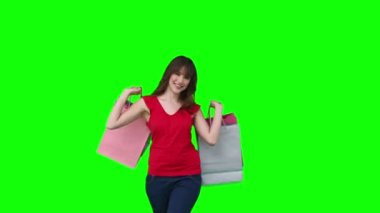 Woman walking while holding shopping bags — Stock Video