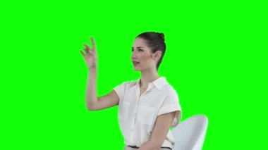 Seated businesswoman using a virtual touchscreen — Stock Video