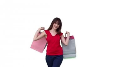 Woman raising shopping bags which she is holding — Stock Video