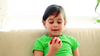 Smiling child eating an apple — Stock Video