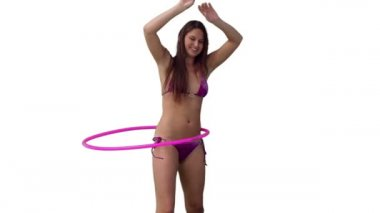 Woman playfully spinning a hula hoop — Stock Video