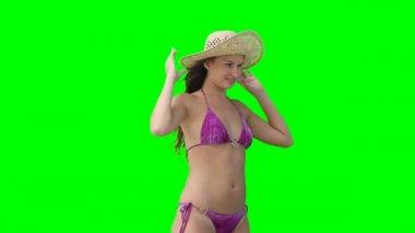 A woman in a bikini eith her hat falling off — Stock Video