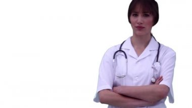 Nurse looking at the camera while folding her arms — Stock Video