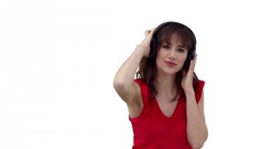 Woman dancing as she listens to music through headphones — Stock Video #21618817