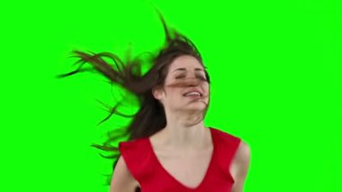 Woman jumping while stroking her hair — Vidéo