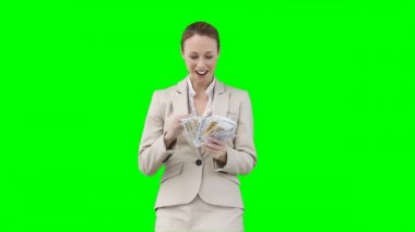A smiling woman counts and shakes all of her money — Stock Video