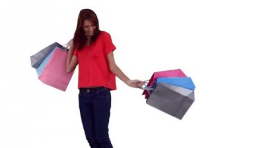 Woman spinning while holding shopping bags — Stock Video