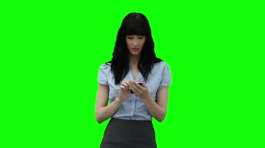 Businesswoman dialing on her mobile phone — Stock Video