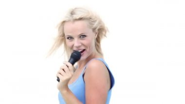 Woman dancing from side to side as she sings into a microphone — Stock Video