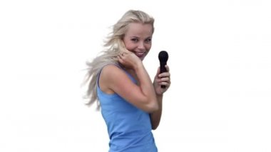 Blonde woman dancing as she sings into a microphone — Stock Video