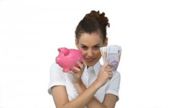 Woman with a piggy-bank and cash in her hands — Stock Video