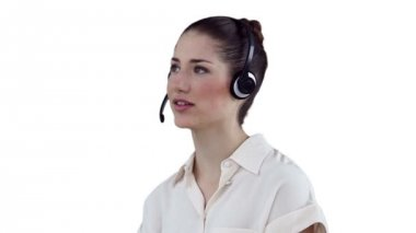 Businesswoman communicating through a headset — Stock Video