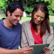 Stock Video: Happy couple looking at tablet computer