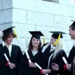 Graduates throwing mortar boards in the air  — Stock Video