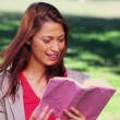 Stock Video: Happy womreading interesting novel