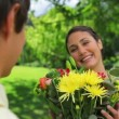 Stock Video: Smiling womreceiving bunch of flowers