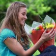 Stock Video: Cheerful womholding bunch of flowers