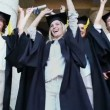 Stock Video: Happy graduated students raising their arms