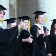 Graduates posing the thumbs-up — Stock Video