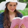 Happy brunette reading a book — Stock Video