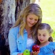 Mother and daughter holding apples — Vídeo de stock