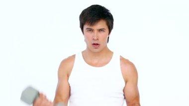 Man using dumbbell — Stock Video