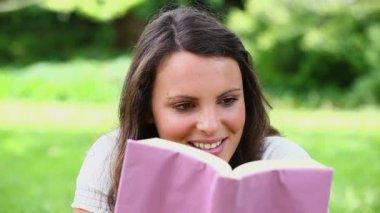 Happy brunette reading a novel — Stock Video