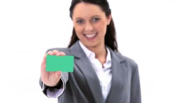 Brunette holding a business card — Stock Video
