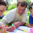 Cheerful family drawing together — Stock Video
