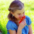 Stock Video: Little girl smelling flower