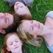 Family lying on the grass — Stock Video