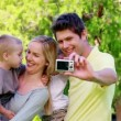 Family taking a picture with a digital camera — Stock Video