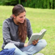 Happy young woman reading a fascinating novel — Stock Video