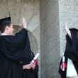 Stock Video: Graduates giving high-five