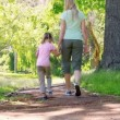 Mother and daughter walking together — Stok video