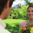 Stock Video: Happy brunette womholding bunch of flowers