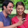 Happy couple receiving surprising text — Stock Video #21635197
