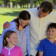 Stock Video: Smiling family standing upright together