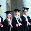 Stock Video: Laughing graduates thumb-up